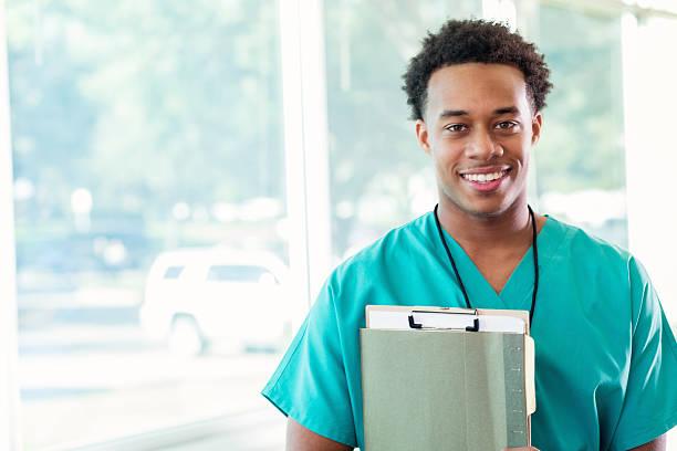 confident medical student before class - vêtements professionnels hospitaliers photos et images de collection