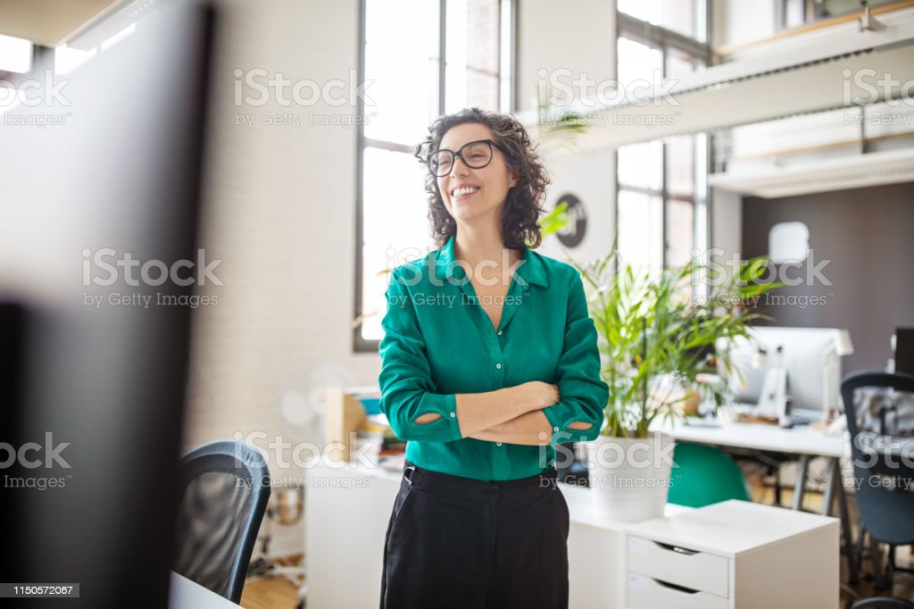Confident mid adult female professional - Royalty-free 40-44 Years Stock Photo