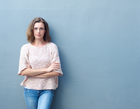 Portrait of a confident mid adult woman posing with arms crossed