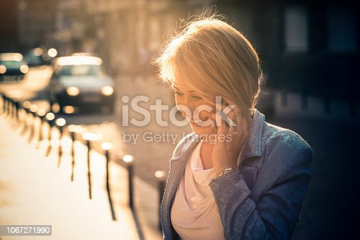 Elegant business woman talking on the mobile phone