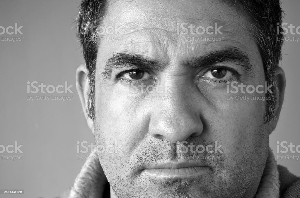 Confident middle aged man looks at the camera stock photo