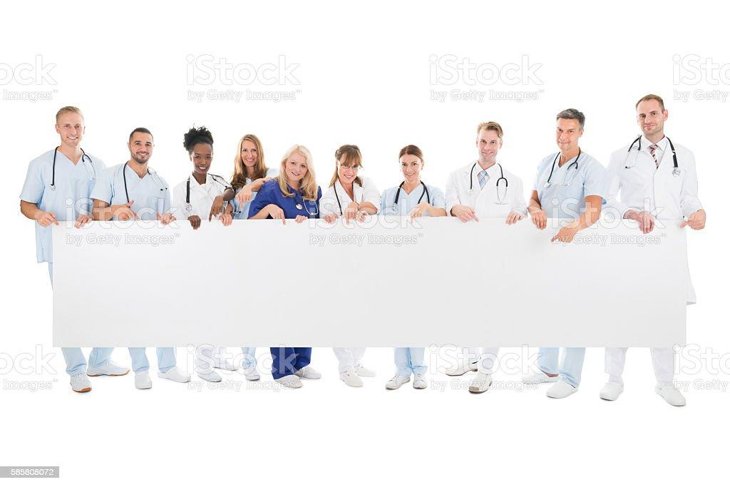 Confident Multiethnic Medical Team Holding Blank Billboard - foto de acervo