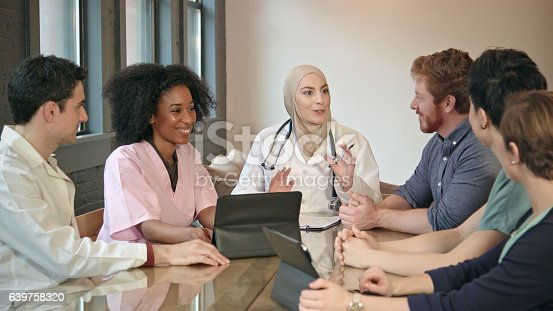 istock Confident Muslim Doctor Meets with Healthcare Professionals 639758320
