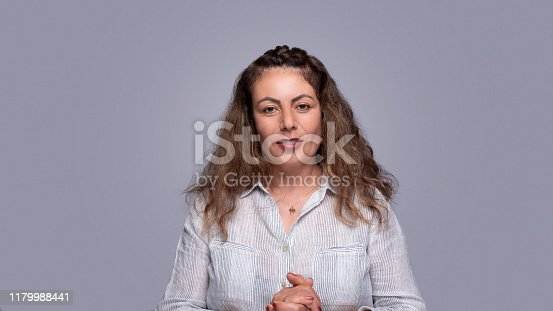 981750034 istock photo Confident natural looking adult woman 1179988441