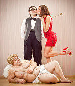 istock confident nerd found love with cupid help for Valentine Day 117150475