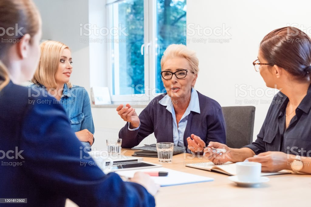 Confident owners discussing in meeting at office Business professionals discussing in meeting. Confident owners are running new business. They are planning strategy at office. 35-39 Years Stock Photo