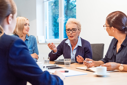 Confident Owners Discussing In Meeting At Office Stock Photo - Download Image Now