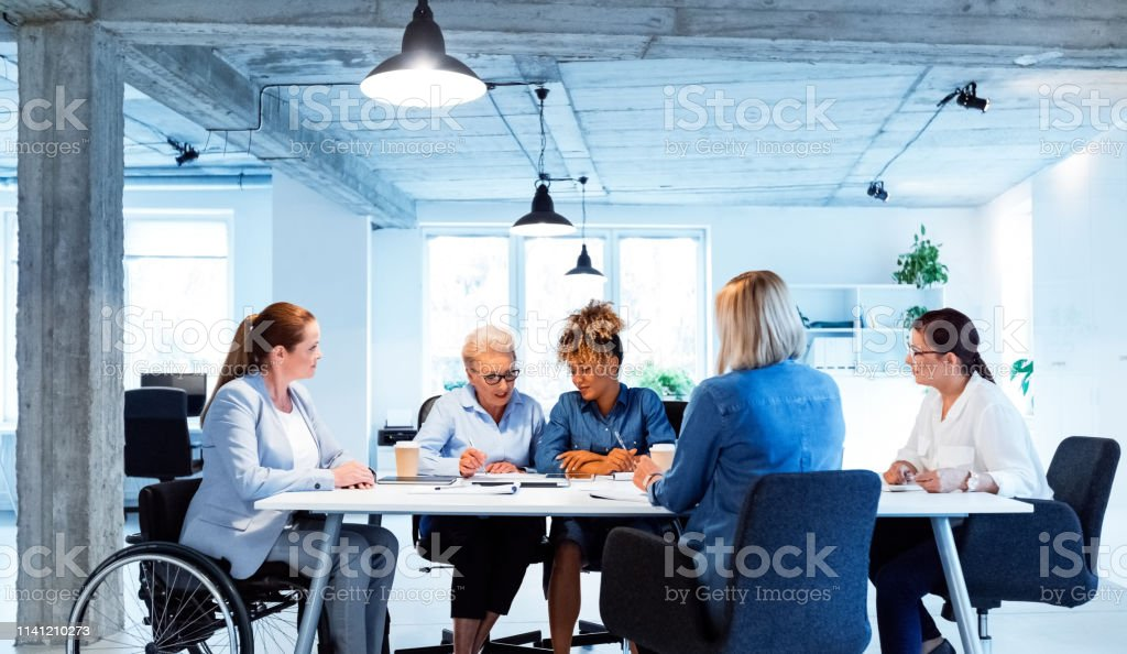 Confident owners planning new business strategies Confident owners planning new business strategies. Businesswomen are working at desk. They are sitting in office. 35-39 Years Stock Photo