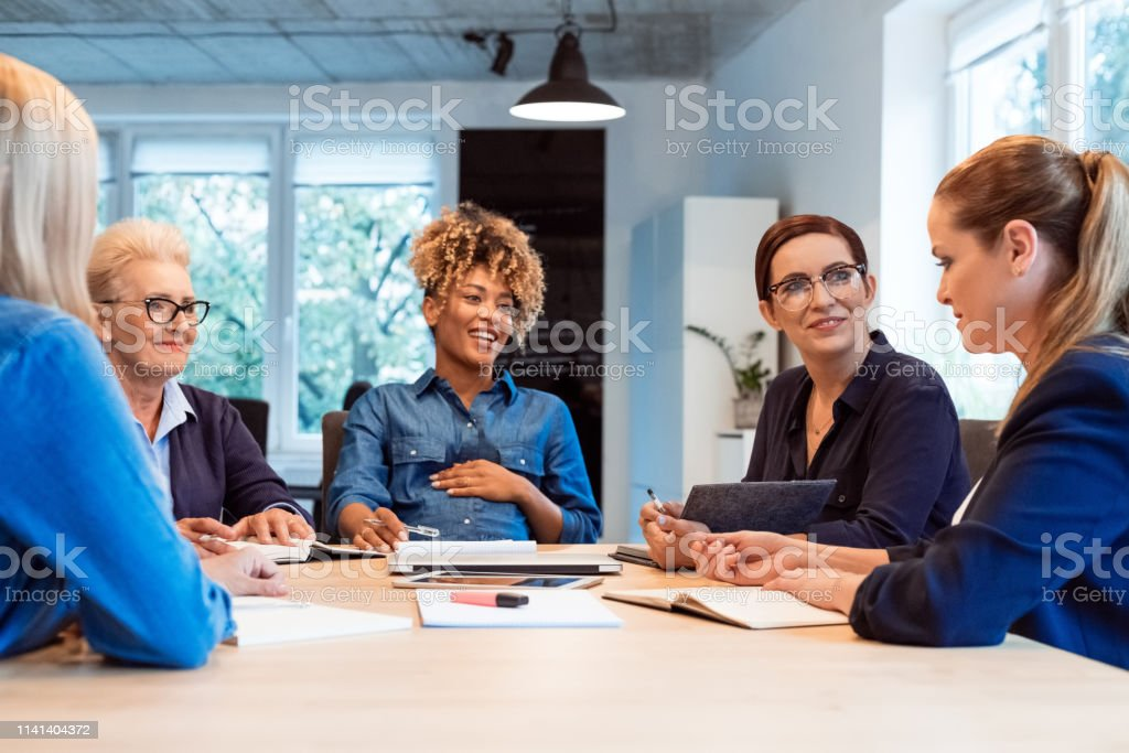Confident owners planning new business strategies Confident owners planning new business strategies at desk. Businesswomen are working in office. They are running start-up business. 35-39 Years Stock Photo