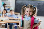 Confident preschooler in her classroom