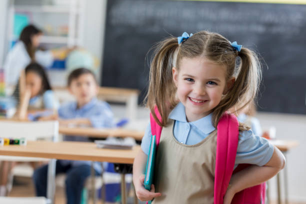 confident preschooler in her classroom - school building stock photos and pictures