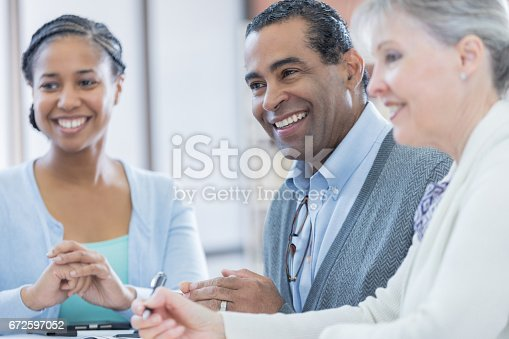 487670635istockphoto Confident professionals attend business meeting 672597052