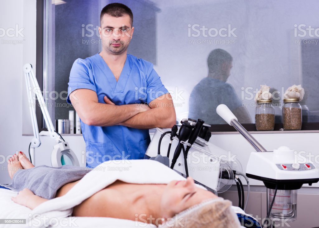 confident qualified cosmetologist in medical center stock photo