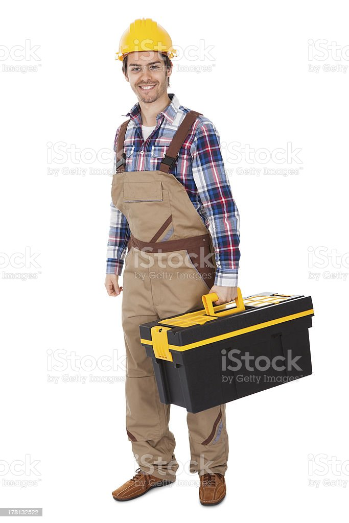 Confident repairman wearing hard hat royalty-free stock photo