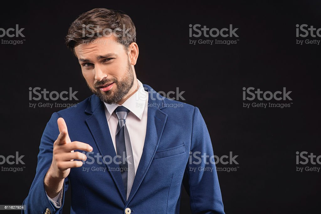Confident rich man showing his authority stock photo