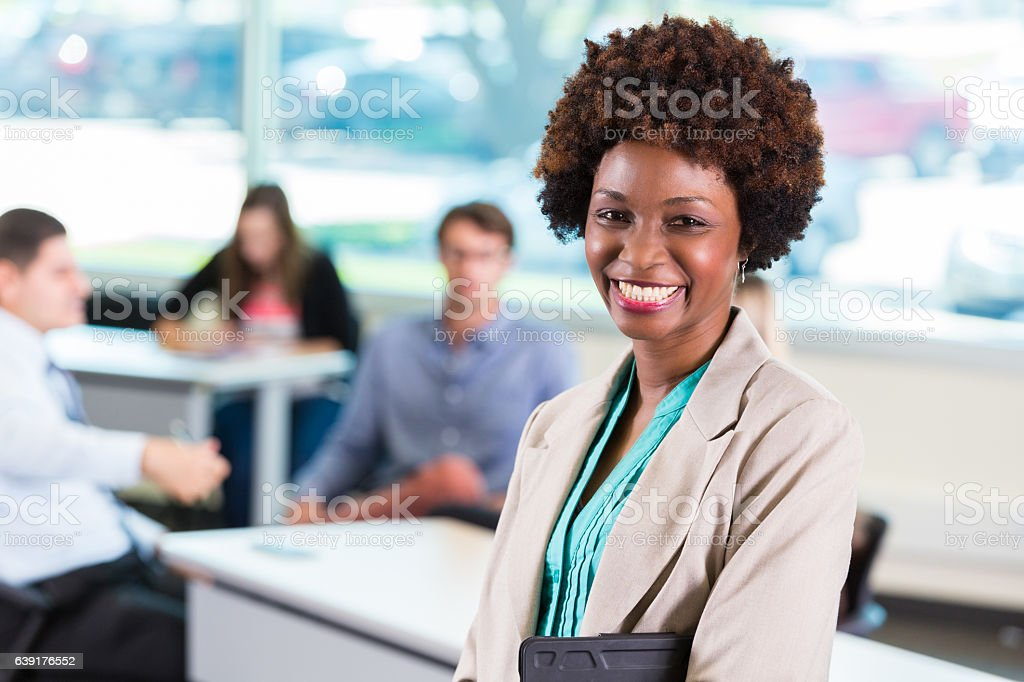 Confident school counselor prepares to meet with students' parents stock photo