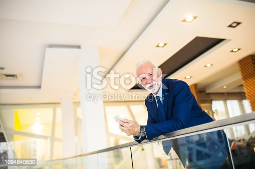 891418990 istock photo Confident senior businessman in the office 1094840830