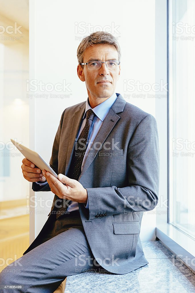 Confident Senior Businessman with Touchpad royalty-free stock photo
