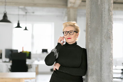Confident Senior Businesswoman Talking On Phone In The Office Stock Photo - Download Image Now