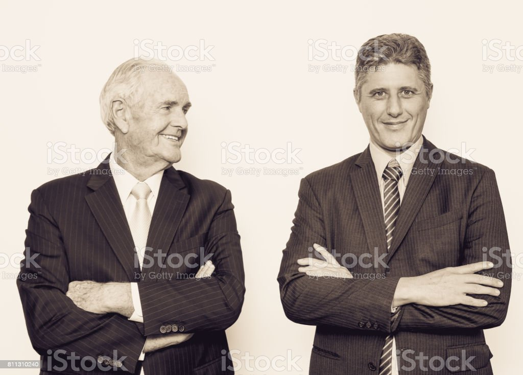 Confident senior man being proud of his son_tone stock photo