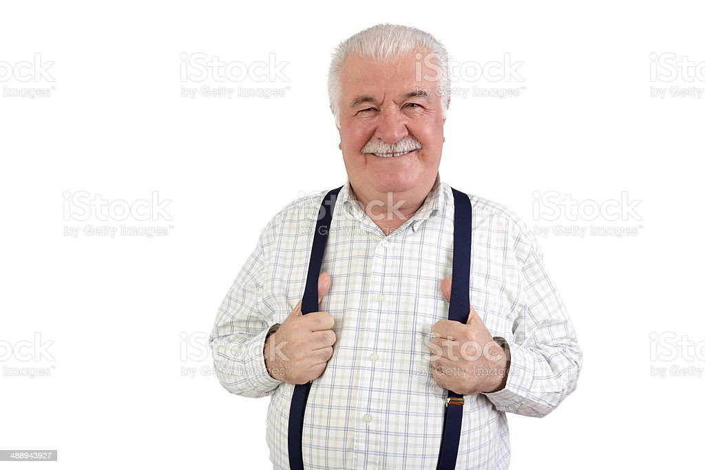 Confident senior man holding his suspenders royalty-free stock photo