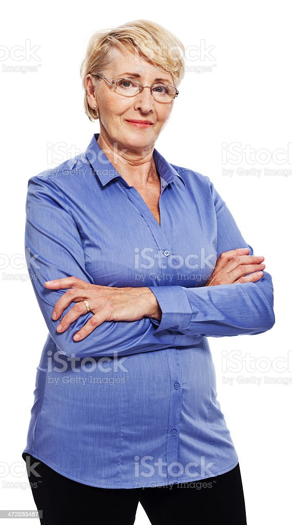 Confident senior woman Portrait of confident senior woman standing with arms crossed and smiling at camera. Studio shot, white background. 60-69 Years Stock Photo