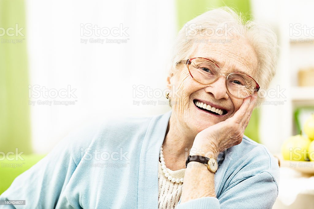 Confident senior woman smiling at camera stock photo