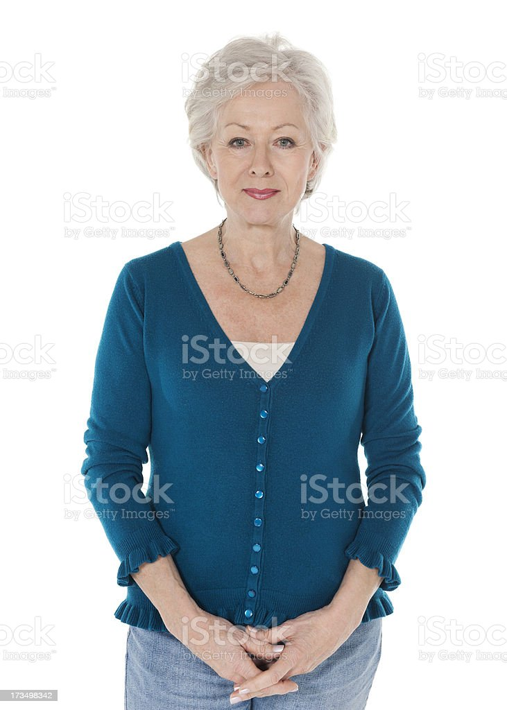 Confident Senior Woman Standing Hands Clasped stock photo