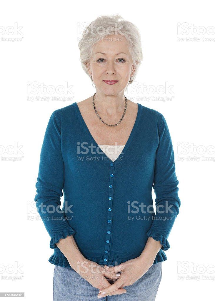 Confiant Senior femme debout, les mains jointes - Photo