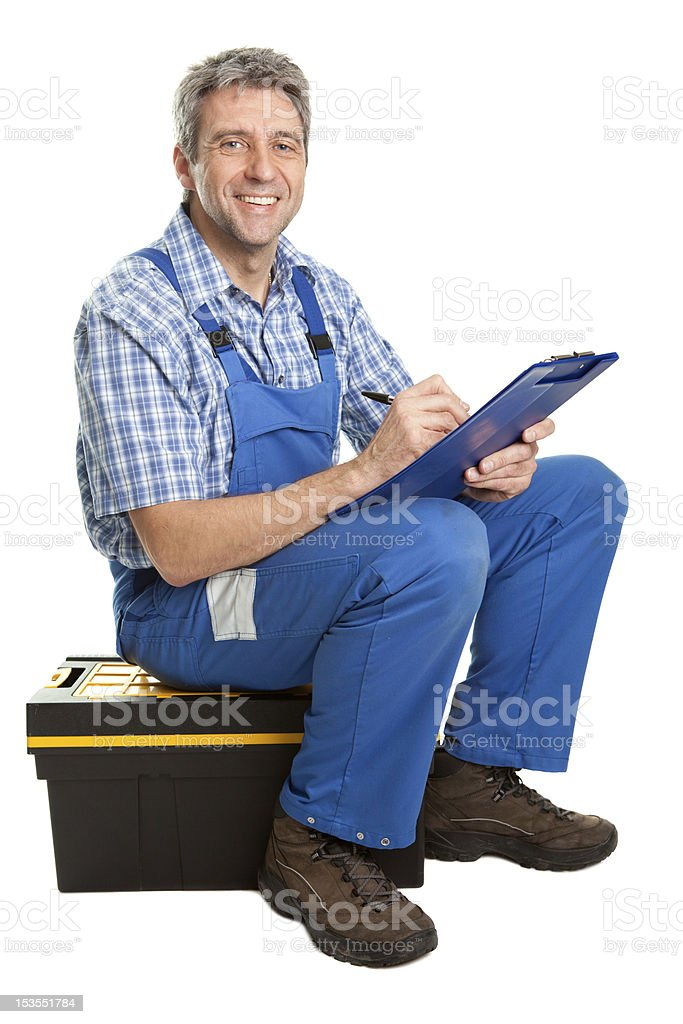 Confident service man taking notes royalty-free stock photo