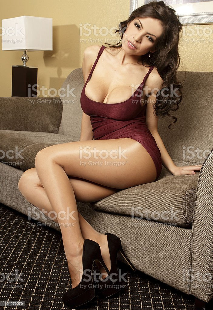 Confident sexy latina in tight cocktail dress and heels stock photo