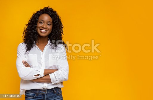Confident Black Girl Crossing Her Hands On Chest And Smiling, copy space
