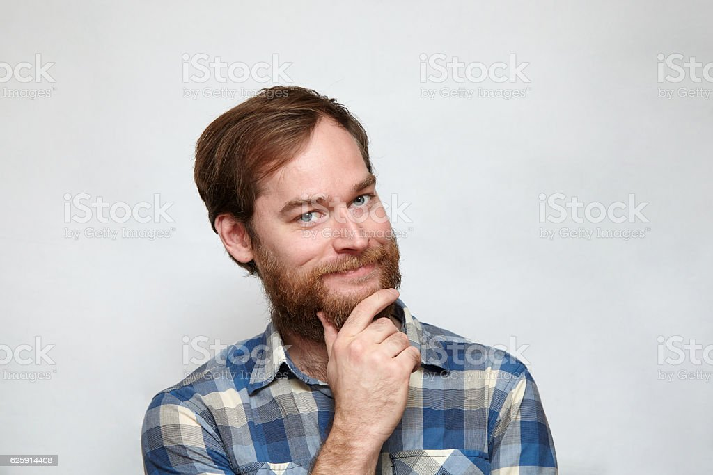 Confident smiling bearded man touching chin – Foto