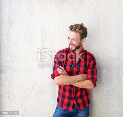 istock Confident smiling man posing with arms crossed 506132162