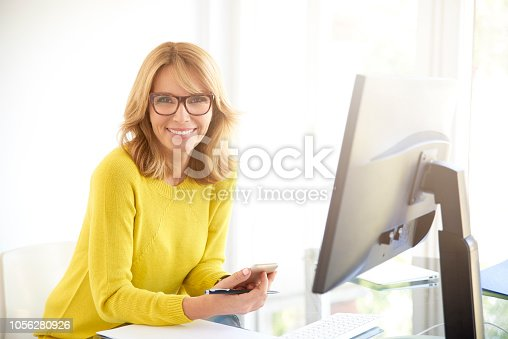 1150572102istockphoto Confident smiling mature businesswoman in the office 1056280926