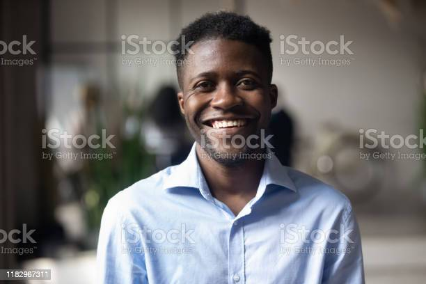 Confident smiling young african businessman looking at camera in picture id1182967311?b=1&k=6&m=1182967311&s=612x612&h=1ghzn euvvsvvc3xixu9pnjuhn1fx uhb9ling6gu2a=