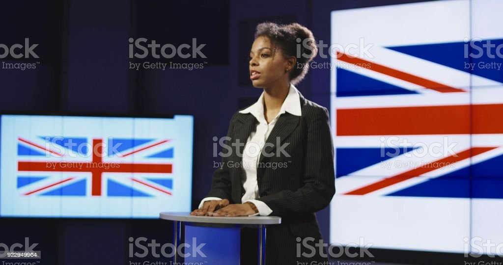 Confident speaker presenting country on conference stock photo
