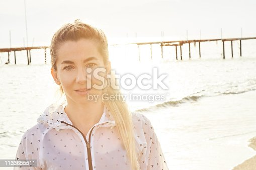 628497270 istock photo Confident Sporty Woman at Beach 1133655511