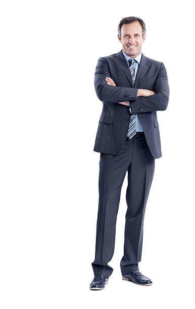 大胆なスタンスを経験豊富なエグゼクティブ - 腕組み スーツ ストックフォトと画像