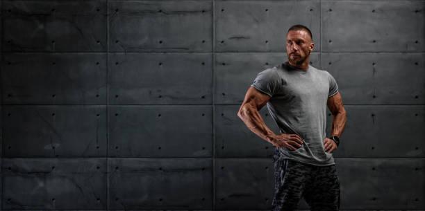 Confident, Strong, Muscular Men Standing Tall stock photo