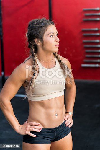 istock Confident strong woman standing in gym 925688746