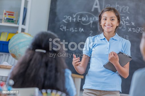 istock Confident student gives speech during class 664838312