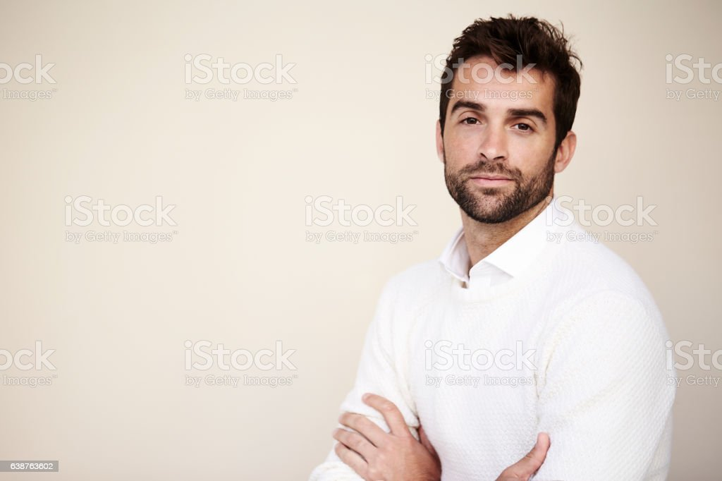 Confident sweater guy stock photo