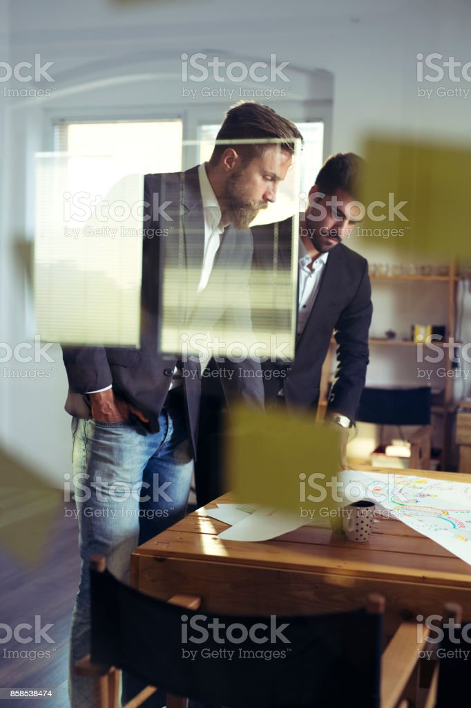 Confident team of engineers working together in a architect studio stock photo