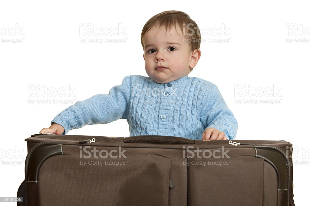 Confident toddler is packing a suitcase royalty-free stock photo
