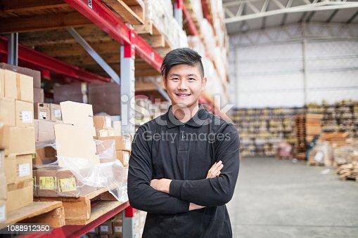 istock Confident warehouse worker 1088912350