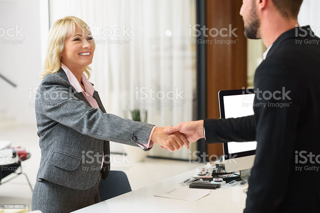 Confident woman buying cosmetology in store stock photo