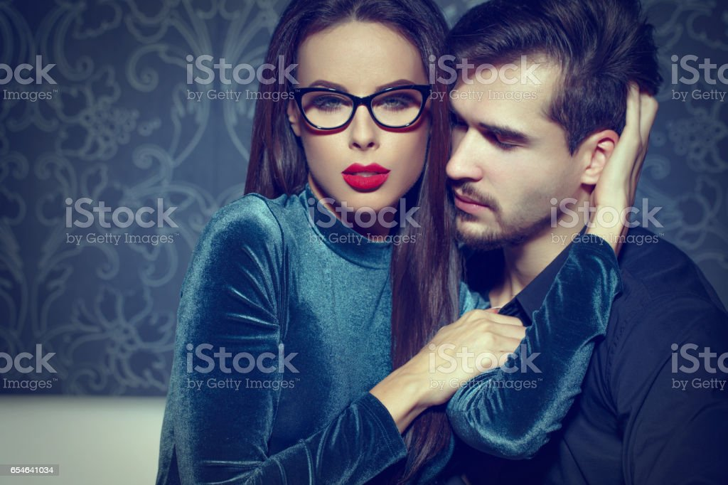 Confident woman entice young rich man, playing with feelings stock photo