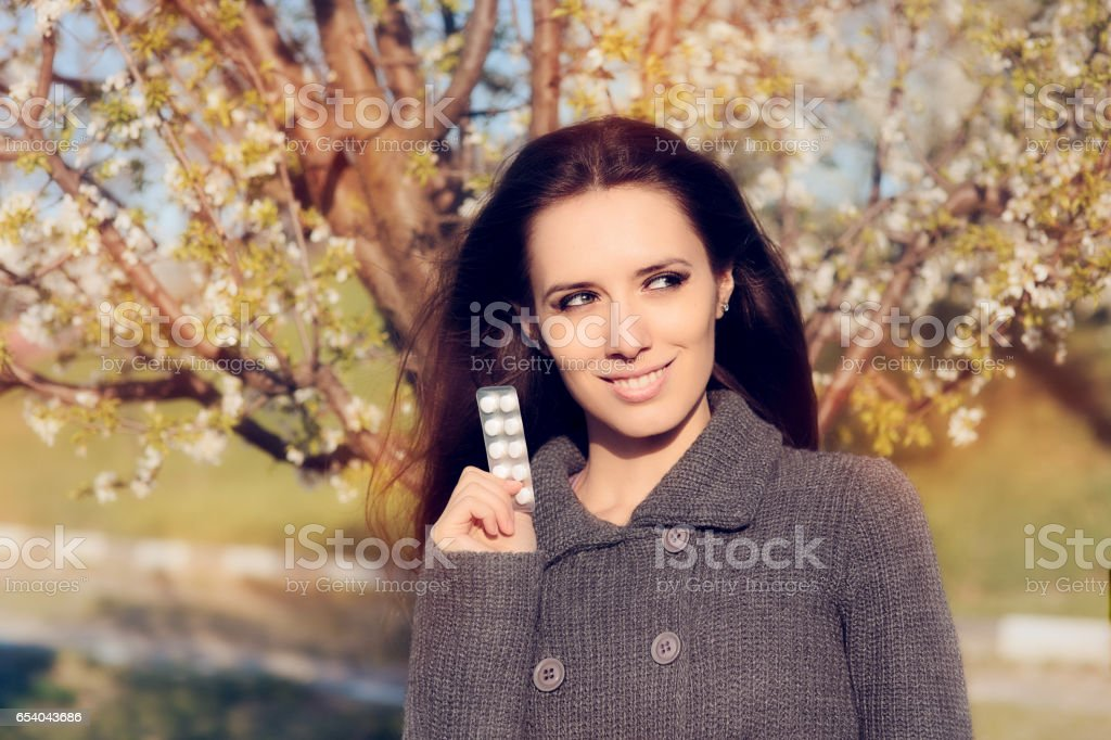 Confident Woman Holding Her Pills Fighting Spring Allergies stock photo