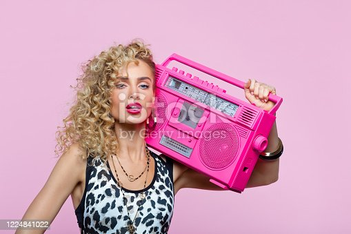 807419930 istock photo Confident woman in 80's style outfit holding boom box 1224841022